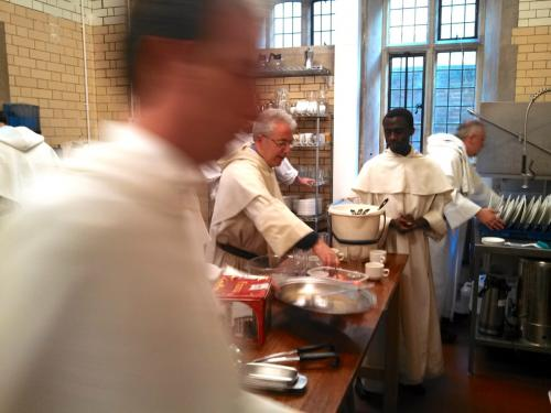 Dominican friars doing dishes after supper in Oxford, England