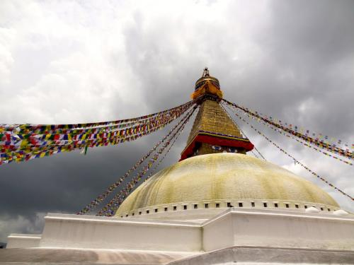 Stupa in the sun with clouds