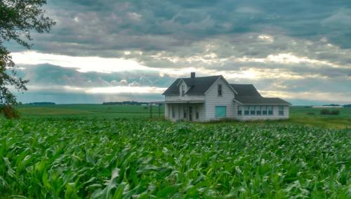 Corn, clouds, and an old farmhouse